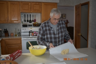 Grandpa making Christmas cookies.